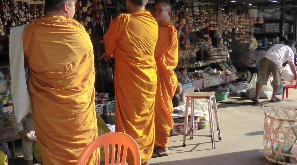 Buddhist Monks decide on a wind chime at Chatuchak Market in Bangkok.