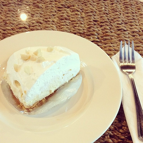 Coconut Heaven Pie, complete with a buttery crunchy crust, topped with toasted macadamia nuts.