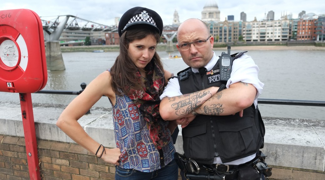 An officer put his hat on me and jumped in my photo along the Thames outside the Tate Modern.